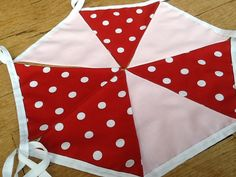 5 Metres - Pastel pink & large white polka dots on a striking red background. Gorgeous and girlie! Each flag is double sided so you can hang the bunting any way you wish.