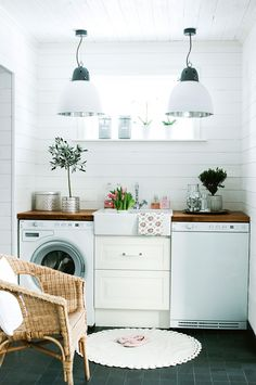 Laundry inspiration – a butler sink is a charming touch. Photography by Anne-Charlotte Andersson.