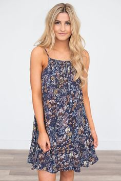 Shop our Smock Top Floral Dress in Dusty Navy Multi. Always free shipping on all US orders!