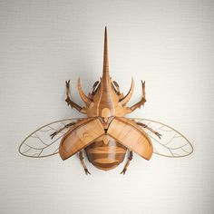 This Wooden beetle was created for folks (like me) who enjoythe beauty and structure of beetles but don't want to kill one so they can can it on their wall.Made digitally using Maya, Vray and Photoshop.Will be part of a set of three insects.