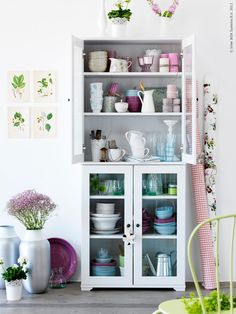 not my colors but I love the stacks & towers of pretty bowls & glasses // ikea blog
