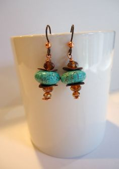 Rich, beautiful disks of turquoise with Czech glass and copper. They dangle under 1 inch from the bottom of niobium hypo-allergenic ear wires.