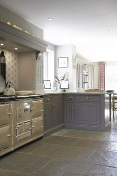 Another beautiful luxury bespoke country kitchen, Harpenden, Herts by Humphrey Munson. The cream Aga, stone floor and grey units are a triumph! Why not head on over to join our FREE interior design resource library at http://www.TheHomeDesignSchool.com/signup ?