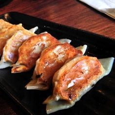 Spam Gyoza - Gyoza made with Hawaii's favorite canned meat... Spam!  If you love spam, you will love this recipe!  Get more recipes on cookinghawaiianstyle.com