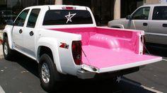 Pink bedliner in a Chevy Colorado