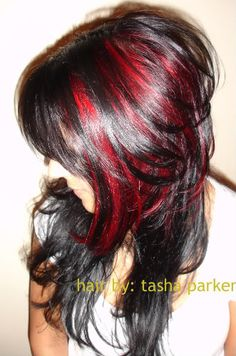 THIS is what I want done to my hair!  It's funky but not freaky (which means when I need to do business people would still take me seriously! :D  Though I'd like it in purple too, this red is awesome...