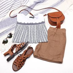 Bohemian bow print top paired with cuffed camel shorts, brown sandals, and sunglasses. Perfect outfit for resort, travel, and vacation!