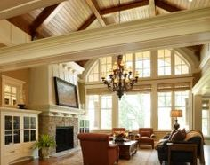 Great Room. Absolutely beautiful! Love the arch and the wood ceiling with exposed beams!