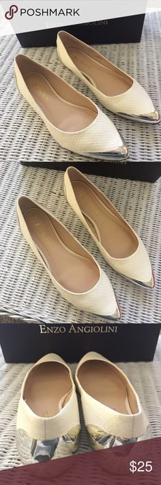 Enzo Angiolini flats sz 7.5 M Very hot flats. Worn a few times. Great condition. Cream color upper with gold like accents. Made made materials. Enzo Angiolini Shoes Flats & Loafers