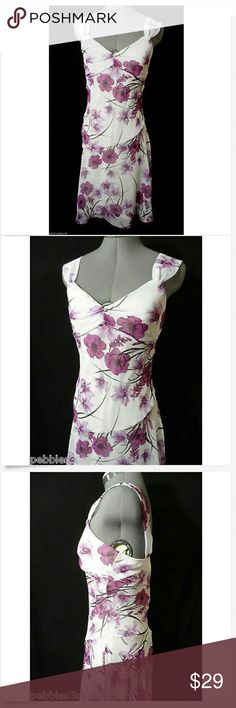 "SPEECHLESS Sun Dress sz 3 White Purple Floral Midi Individual monitors may display slightly different colors or hues...?  SPEECHLESS for JCP Dress  TAG SIZE: 3 BUST: 30"" LENGTH: 40"" from top of the strap (shoulder) down?  Fabulous Floral chiffon dress! Sheath style V neckline Empire waist Knee length Sleeveless White, light & dark purple and brown in color Minimal wash and wear, no flaws I could find. Check out my?other items! Speechless Dresses Midi"