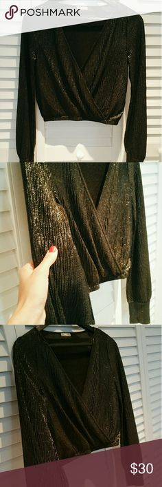 Zara Black Metallic Disco Long Sleeve Top New without tags. Never been worn. Eighties style. Very flatering fit. Size M, fits on the small side. No longer in stores. Zara Tops Blouses