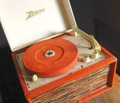 "vintage zenith portable record player... love the orange and the almost wooden-esque accents. perfect to play the one record i own: ""a muppet babies christmas."" rockin."