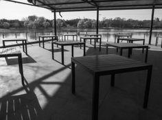 empty terrace, lake, park, tables, shadows