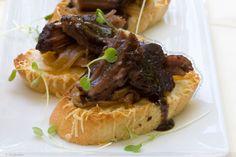 Chocolate Braised Short Rib Crostini with Caramelized Onions and Gruyere