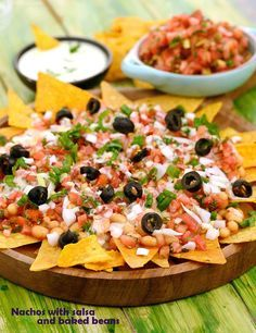 Nachos with Salsa and Baked Beans, with uncooked salsa, baked beans and a creamy cheese sauce arranged temptingly atop corn chips, it causes a burst of flavours and textures in your mouth.