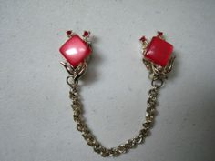 Make sweater clips a from vintage clip earrings. Old necklace chain + jumps.ALady Vintage Retro RED Lucite Rhinestone SWEATER CLIP Looks like CORO not signed