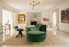 "For a collector's home — ""the client's motivation wasn't about function, it was about provenance"" — Woodson and Rummerfield created a living space that doubles as a well-edited gallery featuring works by Andy Warhol and Ha Jung-Woo. The custom serpentine sofa was designed by the firm, and the pendant light is by Apparatus Studio."