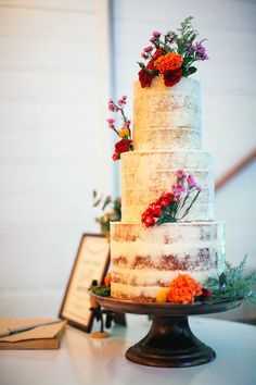 three tiered semi-naked wedding cake with fresh flowers