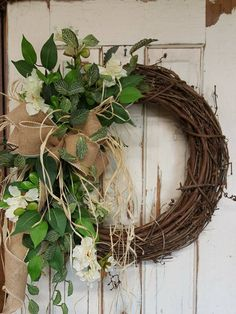 Handmade item Materials: grapevine wreath, glue, wire, wired burlap, realistic fern, realistic greenery, white flowers, wedding flowers, rustic, vintage Made to order Ships from United States Questions? Contact shop owner Item details This beautiful burlap white / greenery wreath