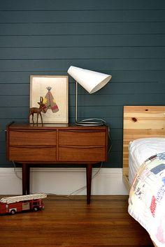 nice dark blue wall paint. Mid-century modern dresser/console.