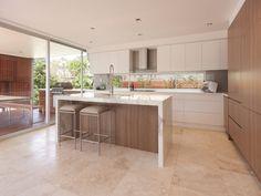 Modern island kitchen design using granite - Kitchen Photo 213774. Love the wooden panelling under the breakfast bar