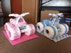 4-Wheelers made out of things for baby. All useable. Basket, diapers, bottle, 4 blankets, bib, wash cloth, and socks. : )   cute!!!!!