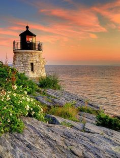 Spyre While Perched On Rocks For Sunset -- Castle Hill Lighthouse in Rhode Island