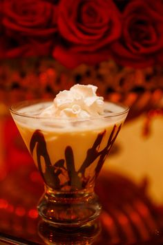 A godiva white chocolate martini with cinnamon and whipped cream.