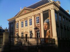 Mauritshuis. I want to see the Girl With Pearl Earring painting! :)