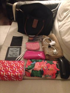 "Purse & contents: far right; beige cashmere scarf & chargers for cell phone & kindle. Sunglasses. Middle row: #2 sleep kit, mask & ear plugs. Nail care kit. Plain pink bag with Tylenol, Tums & inhaler. Cosmetics bag. Far left: Notebook, kindle & ""purse stuff"" money, cards, 2 pens, post it notes & Kleenex. iPhone not shown."