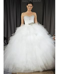 Ines Di Santo; A bodice of beading, crystal sash, and full -- and we mean full -- tulle skirt make this gown totally princess-worthy. Style: Florence,