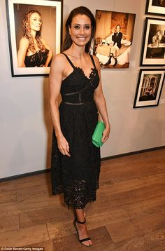Stylish: Melanie Sykes, 46, looked sensational in a plunging bustier style black lace dress for the Sir Hubert Von Herkomer Arts Foundation at the Alon Fine Arts Gallery in London on Wednesday