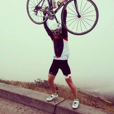 """Vadym triumphant after conquering the Twin Peaks in San Francisco on an incredibly windy day up. """"The KOM"""" went along for the ride.  #rwcyclewear #fitness #wymtm #bibshorts #granfondo #hardmen #cycling #cyclist #ciclista #cycliste #bicycle #ciclismo #bicicleta #velo #shutuplegs #strava #stravacycling #stravaproveit #igerscycling #instabike #roadcycling #roadbiking #roadie #bikeporn  www.redwhite.cc"""