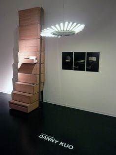 """Danny Kuo product design - storage """"staircase"""". bottom 3 shelves slide out to provide steps to reach the top cabinets"""