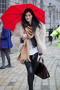 the red brellie really makes the outfit... only in london do you accessorize your umbrella!