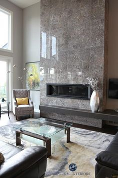 A Contemporary and Comfortable New Home in Nanaimo Tile 2 storey fireplace. Gray and yellow colour palette. Kylie M Interiors E-decor and Online Color Consulting Fireplace Tv Wall, Linear Fireplace, Fireplace Remodel, Living Room With Fireplace, Fireplace Surrounds, Fireplace Modern, Fireplace Ideas, Granite Fireplace, Fireplace Kitchen