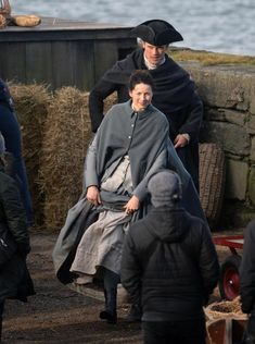 OUTLANDER stars Sam Heughan and Caitriona Balfe brave the weather at Dunure Harbour today as the pair film the hotly-anticipated third season of the time-travelling drama. Pictures show the on-scre…