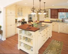 Birch cabinets painted cream in large traditional kitchen - this layout just feels good - not to mention it looks awesome!