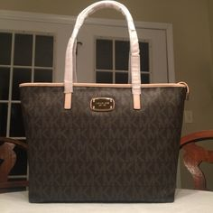 FLASH SALEAUTHENTIC Michael Kors Signature Bag NEW WITH TAGS. Two available.                              COLOR: Brown and Vanilla.                                       SALE PRICE: $185 each!! Michael Kors Bags Shoulder Bags