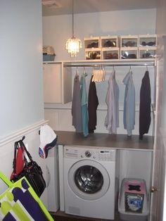 Maybe a short rod between the washer and the fridge to hang shirts on hangers