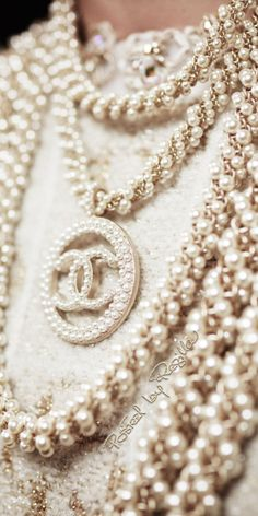 Stacks of Chanel pearl costume jewelry necklaces. Wear the wristbands, Coco Chanel, Chanel Pearls, Chanel Tote, Chanel Jewelry, Jewelery, Jewelry Necklaces, Chanel Necklace, Chanel Clothing, Gold Jewelry