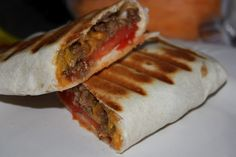 Grilled Cheeseburger Wraps   Brown 1lb ground beef & drain; Add 1 tbsp Worcestershire sauce, 1 tbsp ketchup, 1 tsp dried minced onion, salt & pepper to beef and simmer for 5 minutes   Sprinkle shredded cheese down center of each tortilla (5 large) then add beef mixture to each along with other desired burger toppings;  Roll up tortilla burrito-style and place on preheated indoor grill (i.e. think George Foreman); Grill for approx. 5 minutes or until cheese is melted   Enjoy ♥