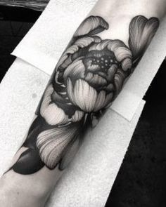 Large peony on forearm by Kelly Violet