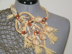 This necklace is all handsewn and very unique. It would be a beautiful accessory to your solo costume or as a group addition. Shell Jewelry, Shell Necklaces, Unique Jewelry, Jewellery, Hawaiian Themed Outfits, Tahitian Costumes, Hula Dancers, Dance Costumes, Shells