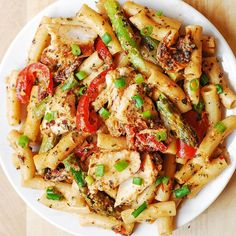 Chicken Alfredo Pasta with Bell Peppers, Asparagus, in a Creamy Sun-Dried Tomato Sauce. The very creamy (and simple) alfredo sauce is made completely from scratch with half and half, freshly grated Parmesan cheese, basil and crushed red pepper! Vegetarian Pasta Recipes, Chicken Pasta Recipes, Easy Salad Recipes, Easy Salads, Cooking Recipes, Healthy Recipes, Dinner Recipes, Snacks Recipes, Breakfast Recipes