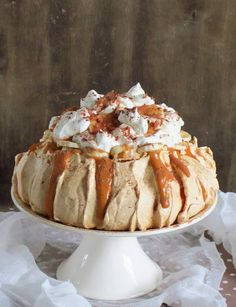 Use vanilla meringue, dulce de leche, fresh bananas, and whipped cream to make this Banoffee Pavlova.