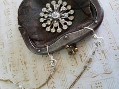 Upcycled coin purse necklace with rhinestone brooch