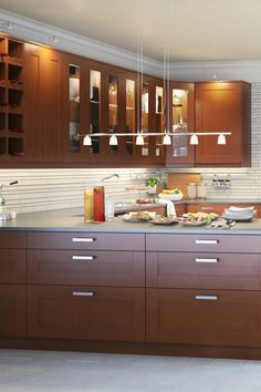 Perched above cabinets, as well as hidden inside and under them, IKEA integrated kitchen lighting adds atmosphere, functionality and style to your kitchen. LED options add energy savings, too! They're a brilliant way to complete the look of your kitchen and get a better look at what you're making for dinner.