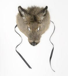 Folktales and beliefs about wild animals often mirror our own hopes and fears. Wolf in Deer's Clothing mask by Teemu Järvi draws from that heritage. The Wolf in Sheep's Clothing - one of Aesop's fables - teaches us that appearances can be deceptive: a lethal wolf masquerades as a meek sheep. Wolf in Deer's Clothing twists this upside down. A deer's skin mask surprisingly looks more like a wolf than a deer: the hunted becomes the hunter. Photo: Unto Rautio