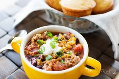 Stacey shares a recipe for the best healthy crock pot turkey chili. The easy recipe is perfect for cold winter nights or for a super bowl party. #chili #Turkey #crockpot